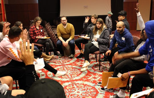 Mark Boergers, chair of the performing arts department at Cardinal Stritch University, leads a discussion about the immigration simulation with his freshman seminar class.