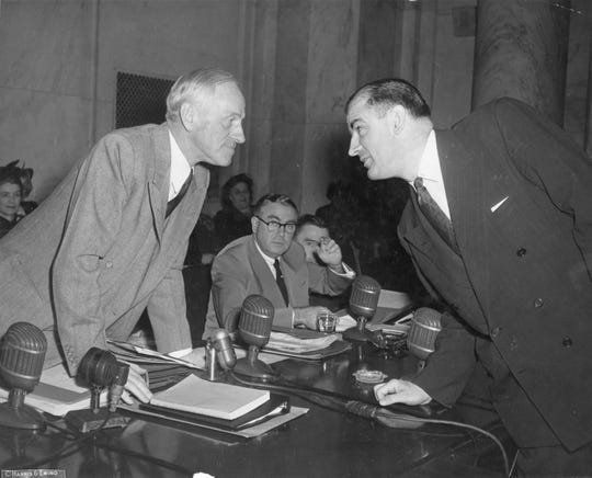 Wisconsin Sen. Joseph McCarthy, right, and Maryland Sen. Millard Tydings face off on the first day of hearings into McCarthy's allegations that scores of communists were working in the State Department.