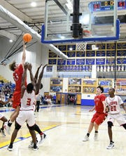 Flippin's Lance May puts up the game-winning shot against Clarendon on Thursday night.