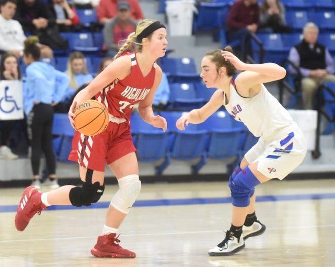 Highland's Abby Dietsche drives against Paragould's Blythe Benefield on Friday afternoon.