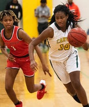 Carver's  Bre'Anna Rhodes (10) drives against Pike Road's Skye Harris-Butler (1) during the Dwight Madison tournament on the Carver campus in Montgomery, Ala., on Friday December 27, 2019.