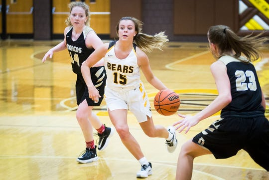 FILE -- Monroe Central's Hannah Bolton slips past Daleville's defense during their game at Monroe Central High School Thursday, Dec. 26, 2019. Bolton became the all-time leading scorer in Monroe Central girls basketball history Wednesday night.