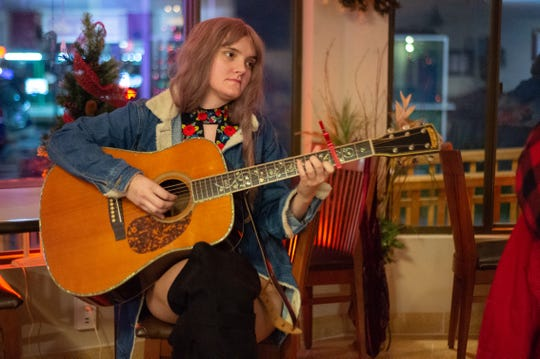 Tammy Sue Taylor gets ready to take the stage during Thursday Songwriter Night at the Stage D'or Coffee Shop in Goodlettsville on Dec. 19, 2019.