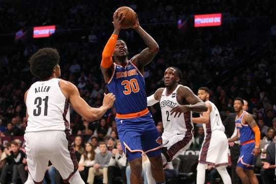 Dec 26, 2019; Brooklyn, New York, USA; New York Knicks power forward Julius Randle (30) drives to the basket against Brooklyn Nets center Jarrett Allen (31) during the first quarter at Barclays Center. Mandatory Credit: Brad Penner-USA TODAY Sports