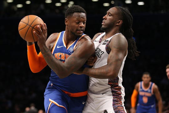Dec 26, 2019; Brooklyn, New York, USA; New York Knicks power forward Julius Randle (30) controls the ball against Brooklyn Nets power forward Taurean Prince (2) during the first quarter at Barclays Center. Mandatory Credit: Brad Penner-USA TODAY Sports