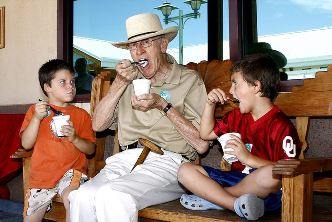 Ashtin Watson, 5, enjoys a cool treat with J. Paul Taylor and Taylor's great grandson Connor Ratje, 5, at the 7th annual Ice Cream Sunday event at the Farm & Ranch Heritage Museum.