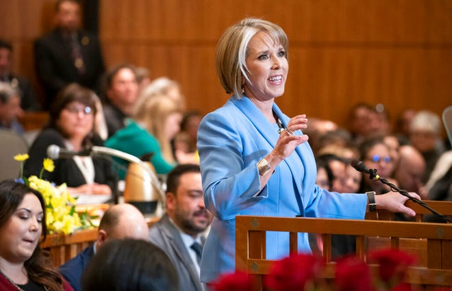 In this Jan. 15, 2019 file photo New Mexico Gov. Michelle Lujan Grisham gives her State of the State address during the opening of the New Mexico legislative session at the state Capitol in Santa Fe, N.M. New Mexico Democrats pushed forward a progressive agenda as the booming oil industry made headlines in 2019 with record revenues for the state's coffers.