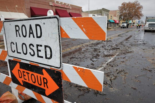 A street closure sign and debris from a cut-down tree are pictured on West Main Street in downtown Farmington on Dec. 27, 2019, as city crews prepare the district for the Complete Streets renovation beginning early next month.