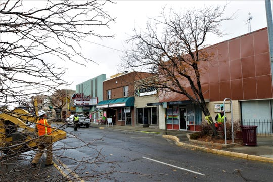 City workers cut down a tree on West Main Street on Dec. 27, 2019, in preparation for the beginning of construction of the Complete Streets project in early January.