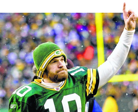 Green Bay Packer quarterback Matt Flynn gestures as he exits the field after defeating the Detroit Lions 45-41 in an NFL football game at Lambeau Field in Green Bay, Wis., on Sunday, Jan. 1, 2012. Aaron Rodgers got to rest up for the playoffs and backup Matt Flynn threw for a franchise-record six touchdowns, the final one to Jermichael Finley with 1:10 left, giving the Packers a 45-41 victory over the Lions.