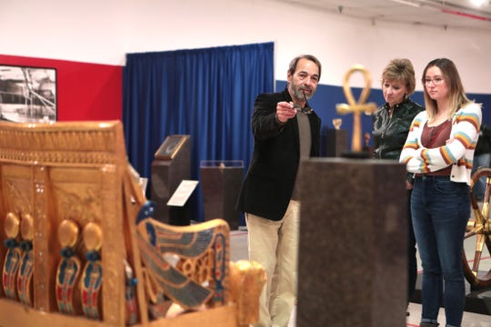Museum of Ancient Wonders Executive Director Alberto Acosta, left, talks about an exhibit inside the museum in Cathedral City, Calif., on Thursday, December 26, 2019.