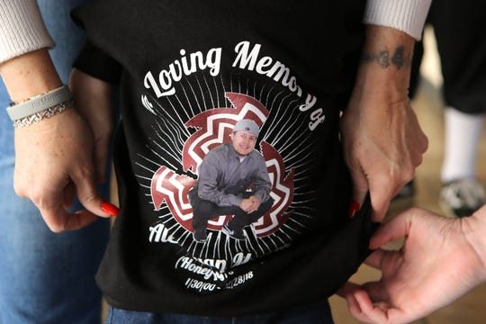 Alex Ryan Marcotte's one and a half year old brother, Kenai Morales, wears a t-shirt with a photo of Marcotte on it inside the Morongo Community Center in Cabazon, Calif., on December 26, 2019. Artea and Marcotte were shot one year ago in Banning. Alex Ryan Marcotte died. His cousin, Dylan Artea survived but became paralyzed. Police are still looking for the suspect.