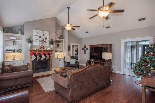 The living area includes a cozy fireplace and cathedral ceilings.