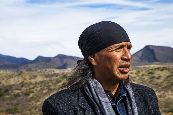 Wendsler Nosie, former chairman of the San Carlos Apache Tribe and leader of Apache Stronghold, surveys land near Skunk Camp Wash where Resolution Copper is already prepping a tailings site even though it's not been approved yet. Nosie is against the tailings site because historical remnants of a Native American village will be destroyed.