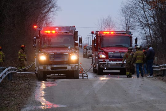 Fire trucks flash their lights while responding to a call.