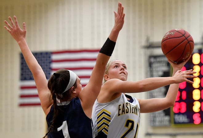 Eastern York's Addison Malone goes around Kylie Meredith of Conrad Weiser for a basket during the Annual Holiday Basketball Tournament, Thursday, December 26, 2019. 