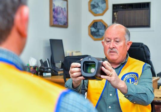 Paul Silva, Yerington Lions Club member, demonstrates the digital eye screening device.