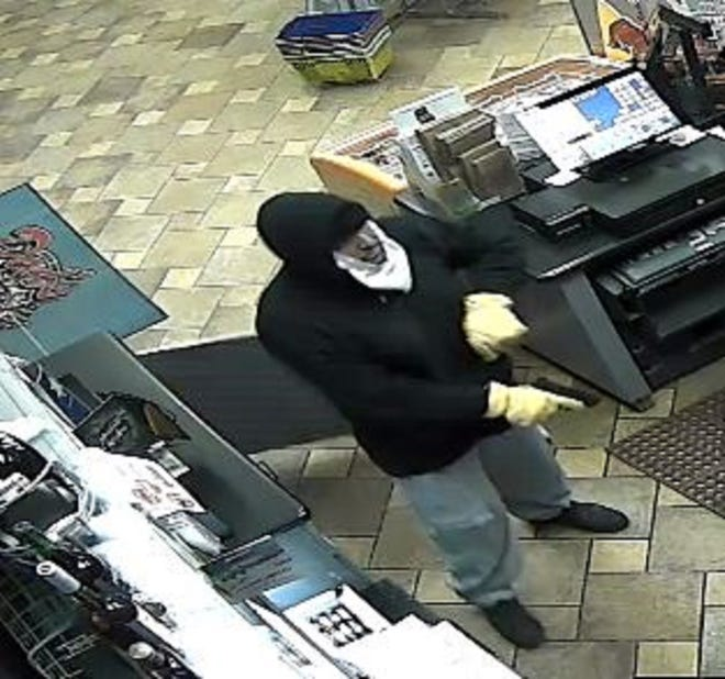 A surveillance photo of a man suspected of robbing two women at gunpoint at a convenience store in Sparks on Dec. 26, 2019.