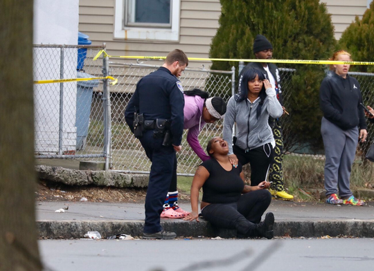 Distraught family and friends of the victim show up on scene of the shooting at Lyell and Plymouth Avenues.