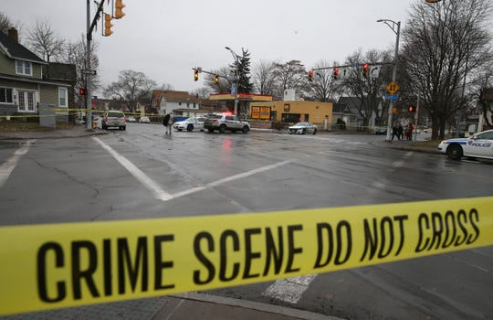 Rochester Police investigate the scene of a homicide near the corner of Lyell and Plymouth avenues in Rochester Friday, Dec. 27, 2019. One man was found dead at the scene.