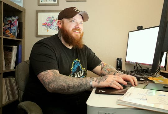 Redding comic book writer Garrett Gunn at his home where he creates stories. A disabled veteran, he started publishing his stories after serving in Afghanistan.