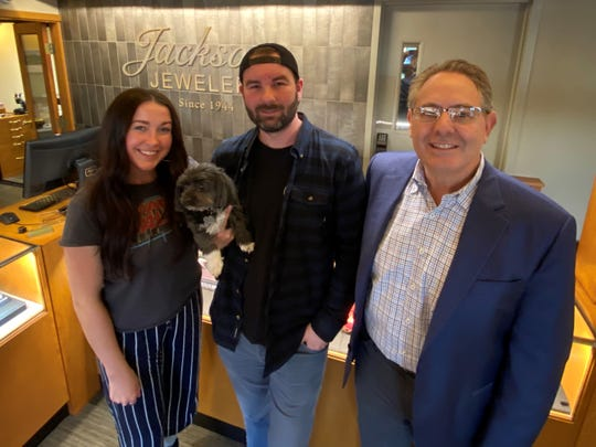 Bentley's Coffee owner Brandon Eastman, center, poses on Dec. 26, 2019, for a photo with Manager Sara Mulder, left, and Jackson's Jewelers owner Ralph Jackson, right. Bentley's Coffee is expanding into a downtown Salem building owned by Jackson. The coffee company is named after Eastman's dog, Bentley, also center.