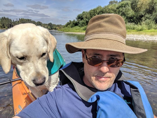 Scott Rick out on the water with his dog.