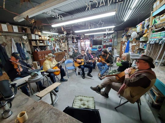 Music circle at The Chicken Farm Art Center during First Saturday event.