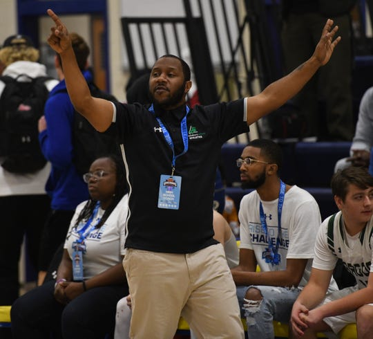 Salisbury School head coach Jermichael Mitchell signals to his players at the Governor's Challenge on Friday, Dec. 27, 2019.
