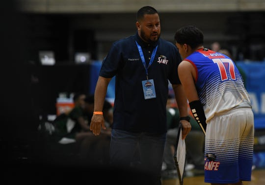 San Felipe head coach Louis Xavier Vidot speaks with Lowy Ruiz during the Governor's Challenge on Friday, Dec. 27, 2019.