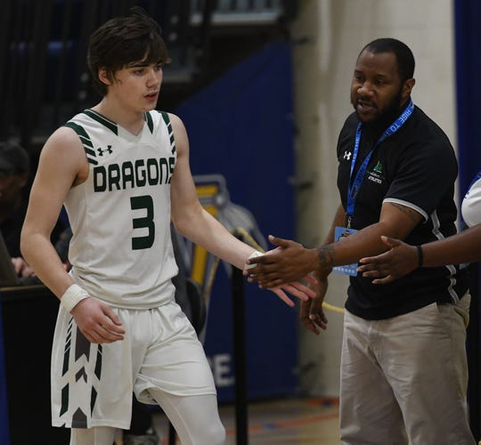 Salisbury School head coach Jermichael Mitchell high fives guard Alexander Carillo at the Governor's Challenge on Friday, Dec. 27, 2019.