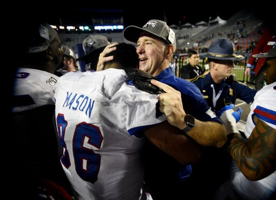 LA Tech head coach Skip Holtz hugs Ka' Derrion Mason when they win the 2019 Walk-On's Independence Bowl against the Miami Hurricanes Thursday evening, December 26 at Independence Stadium in Shreveport, Louisiana.