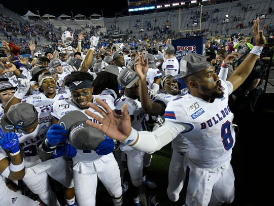 Louisiana Tech players celebrate after beating Miami in the Walk-On's Independence Bowl.