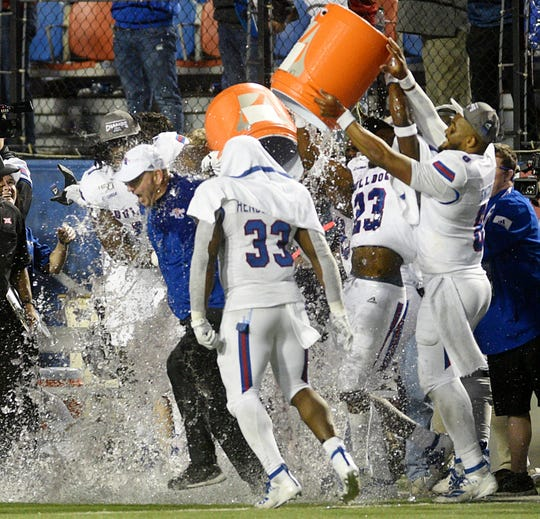 LA Tech head coach Skip Holtz gets drenched by his players when they win the 2019 Walk-On's Independence Bowl against the Miami Hurricanes Thursday evening, December 26 at Independence Stadium in Shreveport, Louisiana.