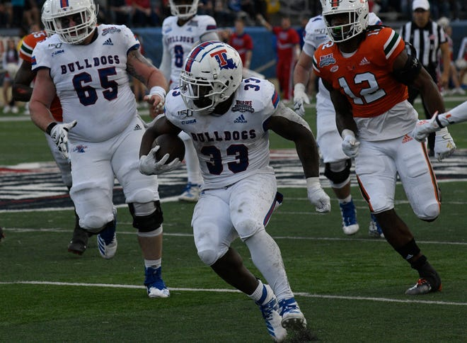 Louisiana Tech's Justin Henderson runs the ball against Miami in the Walk-On's Independence Bowl.