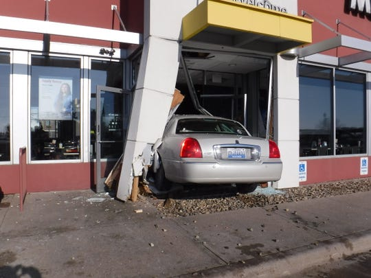 One person was injured after a car crashed into a Watertown McDonald's on Friday.