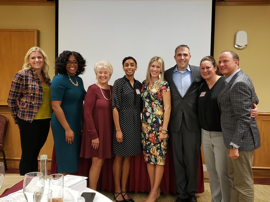 CHSF Hall of Fame Alumni Award Recipients: (from left to right): Adrienne Hall, Auriel Rolle-Polk Kirkland, Merry Ortega, Dr. Zita Magloire, Maria Hampton Waters, Michael Lewis, Megan Higginbotham and Herbie Thiele.
