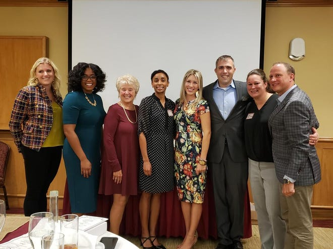 CHSF Hall of Fame Alumni Award Recipients: (from left to right): Adrienne Hall, Auriel Rolle-Polk Kirkland, Merry Ortega, Dr. Zita Magloire, Maria Hampton Waters, Michael Lewis, Megan Higginbotham and Herbie Thiele.
