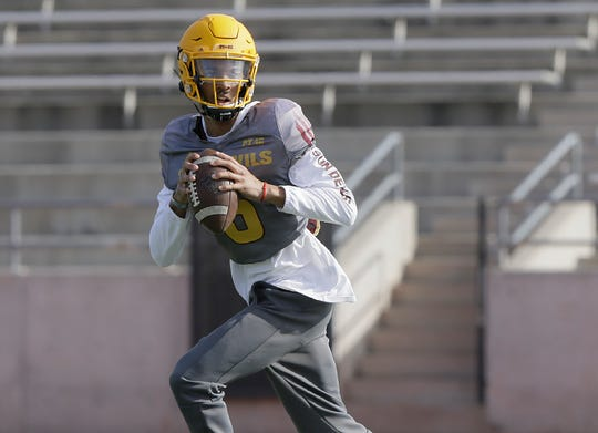 Arizona State quarterback Jayden Daniels looks for a receiver during the team's first practice in El Paso Friday.