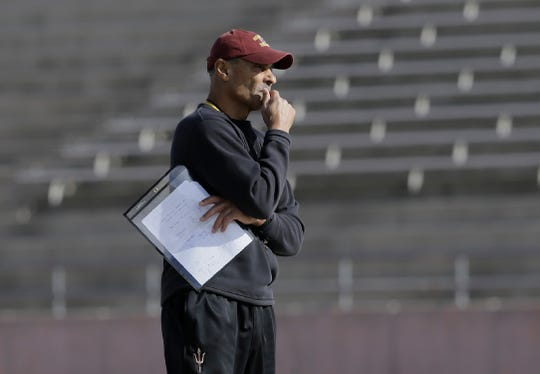 Arizona State head football coach Herm Edwards watches practice from midfield as they prepare for Florida State in the Tony the Tiger Sun Bowl.