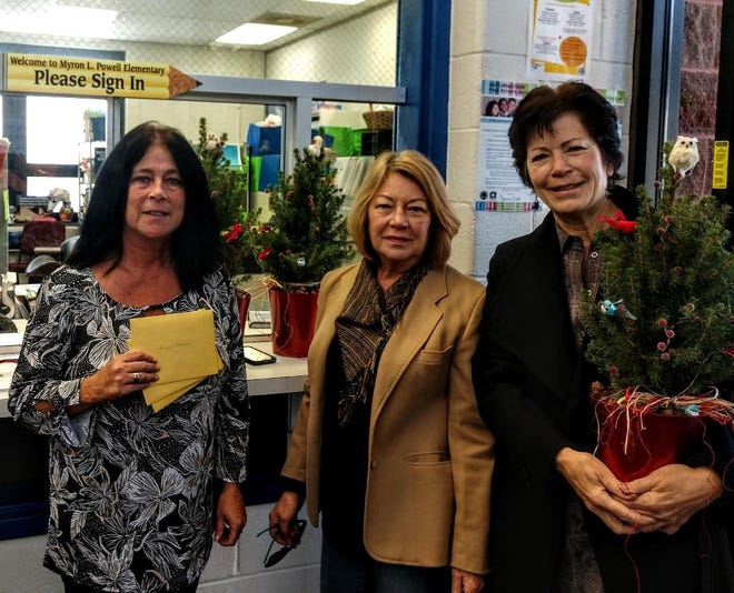 (From left) Jackie Cook from Myron Powell School in Cedarville accepts gifts on behalf of three students and their families from Linda Finch and Kathy Geiger, representing the Master Gardeners of Cumberland County.
