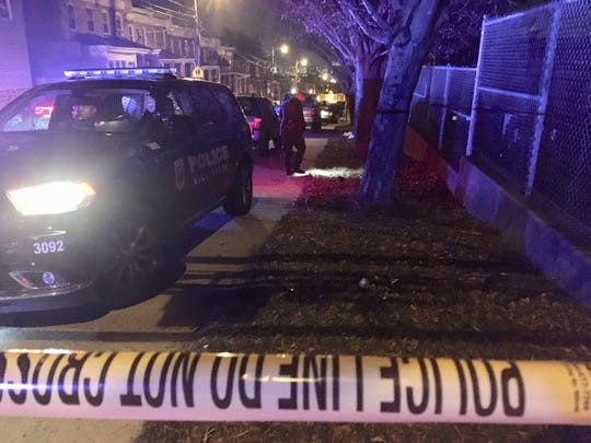 Police investigate a shooting on the 1300 block of Cedar Street Thursday night.