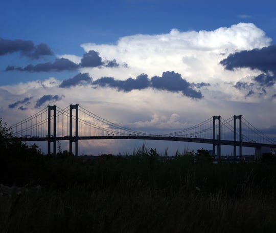 A storm moves away from the Delaware Memorial Bridge in June.