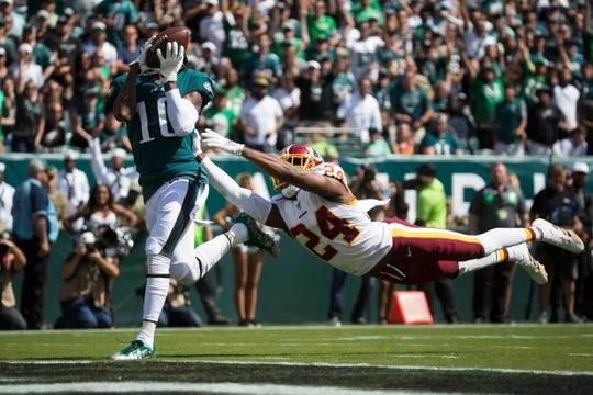 Eagles' DeSean Jackson (10) brings in a deep pass in front of a diving Josh Norman (24) to score Sept. 8 at Lincoln Financial Field.