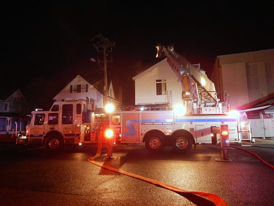 Firefighters from Rehoboth Beach Volunteer Fire Company battle a multi home fire early Friday morning on Olive Avenue in downtown Rehoboth Beach.