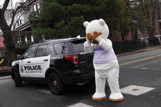 A man dressed in bear costume makes fun of the frenzy over a bear that was being chased by police and wildlife experts in Trolley Square in early December.