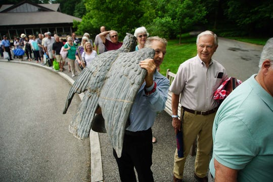 "Jamieson Wilson, of Little Washington, N.C., holds an eagle taken off a post office in Port Chester, N.Y. in 1933. Wilson was waiting for tram to take him up to Winterthur Museum where the ""Antiques Roadshow"" was filming a show for Season 24 in June."