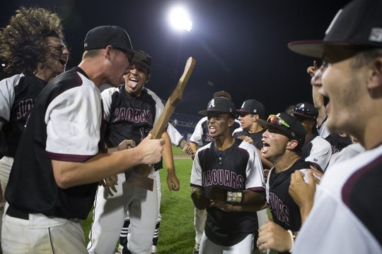 Appoquinimink celebrates winning the DIAA Baseball State Title against Caravel Academy 3-0 in June at Frawley Stadium.
