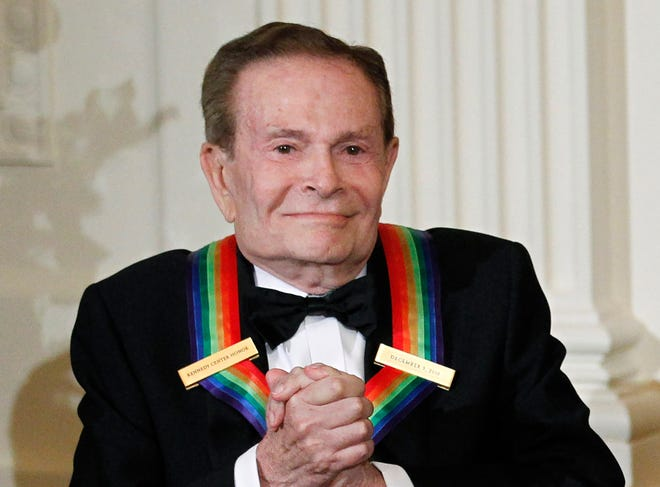 Composer Jerry Herman, one of the recipients of the 2010 Kennedy Center Honors is introduced during a reception in the East Room of the White House in Washington on Dec. 5, 2010.