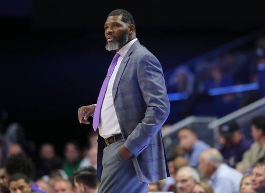 Evansville coach Walter McCarty watches his team against Kentucky during their 2019 game at Rupp Arena.